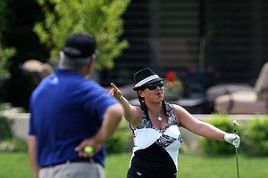 Christina Kim celebrates holing out at No. 16 from the fringe during her pro-am.