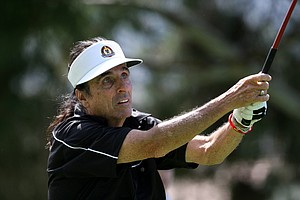 Alice Cooper watches his tee shot at No. 17 during Wednesday's pro-am. He and his LPGA partner, Sun Young Yoo posted a 63.