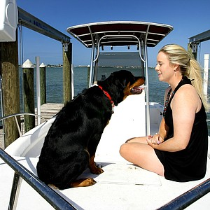 Tampa, Fla.--04/08/10--Brittany Lincicome on her boat with her Rottweiler, Major.