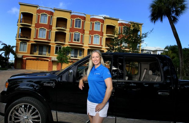Tampa, Fla.--04/08/10--Brittany Lincicome with her truck(Biff has the specifics) in front of her condominium building near Tampa.