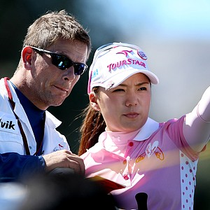 Chie Arimura  talks with her caddie at No. 6. Arimura posted an opening round of 68.