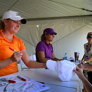 Stacy Lewis and Anna Nordqvist sign autographs after their second round of play.