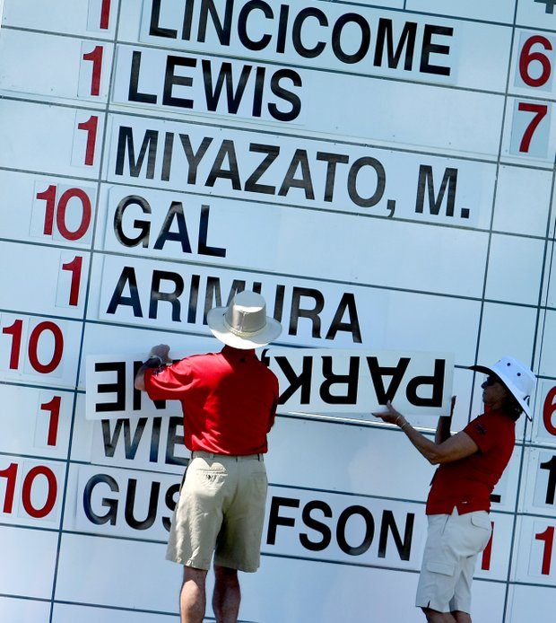 Jane Park's name, upside down, goes on the leaderboard during the second round.