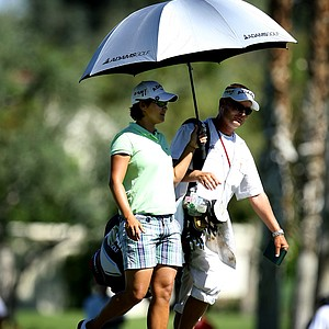 Yani Tseng and her caddie Jason Hamilton walk down the second fairway on Friday.