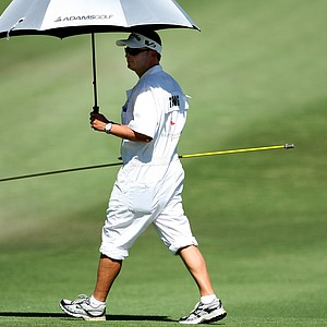 Yani Tseng's caddie Jason Hamilton tries to beat the heat during the second round. For the second day in a row, temperatures reached into the 100s.