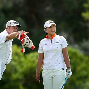 Amy Yang talks with her caddie at No. 6 during the third round.