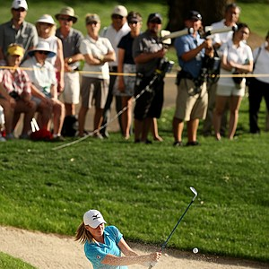 Stacy Lewis hits out of a bunker at No. 17 during the third round. Lewis lost the lead to Yani Tseng heading into Sunday.
