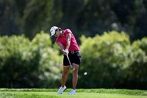 Yani Tseng hits her tee shot at No. 6. The defending champions lost by 3 to Stacy Lewis.