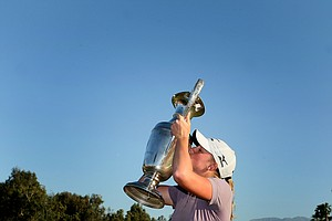 Stacy Lewis kisses the trophy after winning the 2011 Kraft Nabisco Championship.