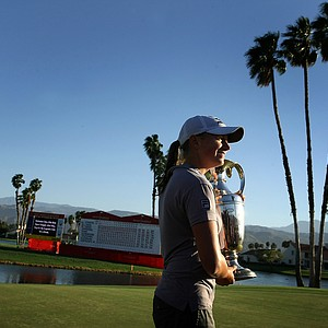 Stacy Lewis holds the trophy after winning the 2011 Kraft Nabisco Championship.