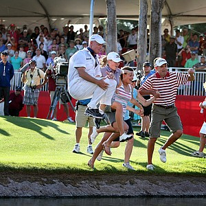 Stacy Lewis and her caddie, Travis Wilson, along with her sister, mom and dad, jump into Poppie's Pond.