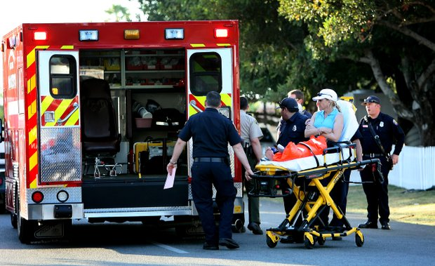 Carol Lewis, Stacy's mom, is loaded into an ambulance after jumping into Poppie's Pond at the Kraft Nabisco Championship.