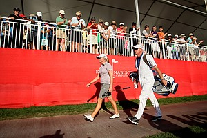 Stacy Lewis and her caddie, Travis Wilson, walk to the 18th green during the final round.