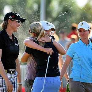 Stacy Lewis gets sprayed with champagne at No. 18 by fellow players.