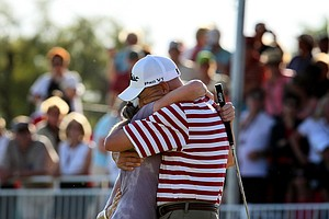 Stacy Lewis gets a big hug from her dad, Dale, after she won the 2011 Kraft Nabisco Championship.