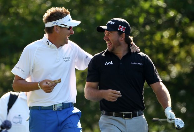 Ian Poulter (L) of England and Graeme McDowell of Northern Ireland walk off a tee during a practice round prior to the 2011 Masters Tournament at Augusta National Golf Club on April 4, 2011 in Augusta, Georgia.