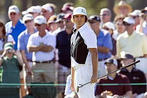 Rickie Fowler of the US is seen on the 9th green during a practice round prior to the 2011 Masters Tournament at Augusta National Golf Club April 4, 2011 in Augusta, Georgia.