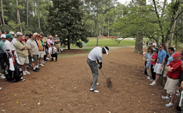 Vijay Singh of Fiji hits out of the rough off the 10th fairway during the second round of the Masters golf tournament at the Augusta National Golf Club in Augusta, Ga., Friday, April 10, 2009.