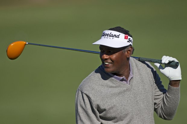Vijay Singh of Fiji watches the action at the driving range as he prepares for the Masters golf tournament at the Augusta National Golf Club in Augusta, Ga., on Sunday, April 3, 2011.