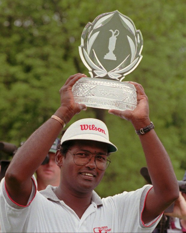 Vijay Singh holds the Memorial Tournament winner's trophy over his head for photographers after winning the rain-shortened tournament Monday, June 2, 1997, in Columbus, Ohio. Singh finished at 14 under par for the 54 hole tournament.