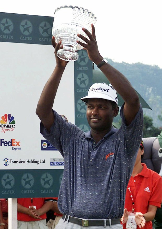 Fijian Vijay Singh holds the trophy aloft after winning the Singapore Masters at the Singapore Island Country Club held in Singapore Sunday, Feb. 25, 2001.