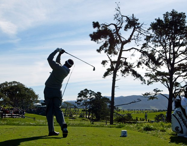 Vijay Singh follows his shot from the fifth tee of the Pebble Beach Golf Links during the final round of the AT&T Pebble Beach National Pro-Am in Pebble Beach, Calif., Sunday Feb. 8, 2004. Singh won the tournament by three strokes after shooting a three-under-par 69 to finish at total 16-under-par.