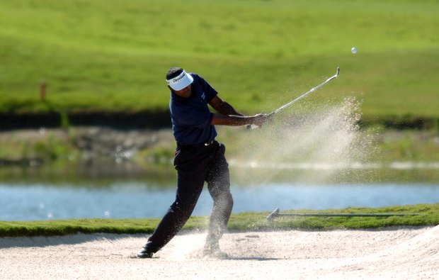 Vijay Singh, of Fiji blast of a sand trap from the 17th green during the third round at Honda Classic, Saturday, March 12, 2005, in Palm Beach Gardens, Fla.