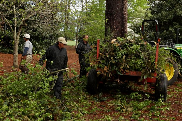 Members of the grounds staff clear debris from the course after an overnight storm prior to the 2011 Masters Tournament at Augusta National Golf Club on April 5, 2011 in Augusta, Georgia.
