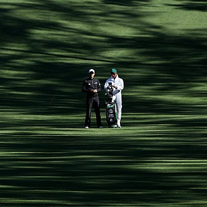 Camilo Villegas of Colombia chats with his caddie Michael Doran during a practice round prior to the 2011 Masters Tournament at Augusta National Golf Club on April 5, 2011 in Augusta, Georgia.