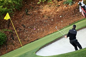 Martin Kaymer of Germany plays a bunker shot during a practice round prior to the 2011 Masters Tournament at Augusta National Golf Club on April 5, 2011 in Augusta, Georgia.