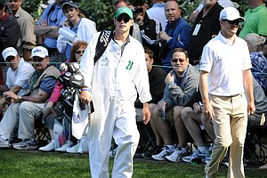 Andy Roddick (L) caddies for Zach Johnson during the Par 3 Contest prior to the 2011 Masters Tournament at Augusta National Golf Club on April 6, 2011 in Augusta, Georgia.