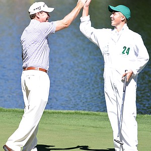 Tom Watson celebrates with his caddie during the Par 3 Contest prior to the 2011 Masters Tournament at Augusta National Golf Club on April 6, 2011 in Augusta, Georgia.
