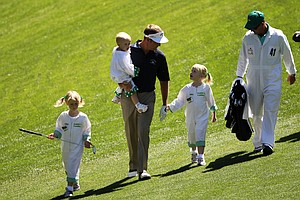 tuart Appleby of Australia walks with his children Max, Mia, and Ella watch the action during the Par 3 Contest prior to the 2011 Masters Tournament at Augusta National Golf Club on April 6, 2011 in Augusta, Georgia.