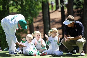 Stuart Appleby talks with his children (L-R) Max, Mia, and Ella watch the action during the Par 3 Contest prior to the 2011 Masters Tournament at Augusta National Golf Club on April 6, 2011 in Augusta, Georgia.
