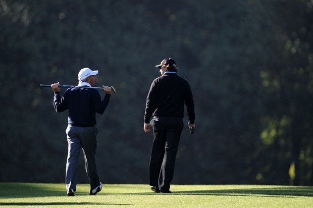 Phil Mickelson (right) walks alongside Fred Couples at Augusta National.