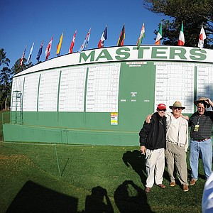 Spectators take snapshots as they arrive for the final Masters practice round before play kicks off Thursday.