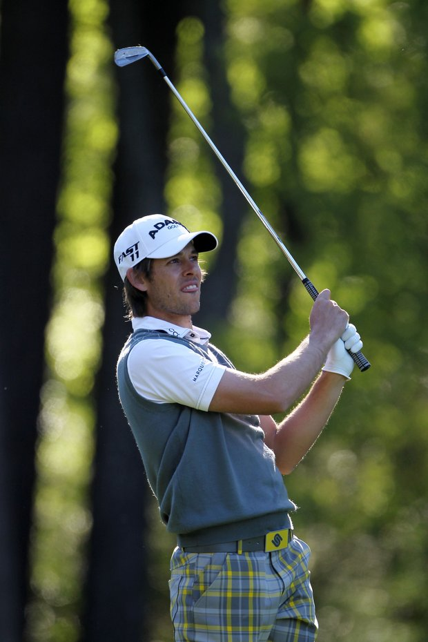 Aaron Baddeley of Australia watches a shot during a practice round for the Masters.
