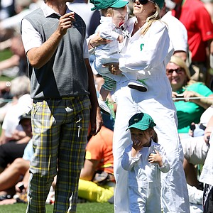 Aaron Baddeley of Australia chats with his wife Richelle and daughters Jewell and Jolee during the Masters Par 3 Contest.