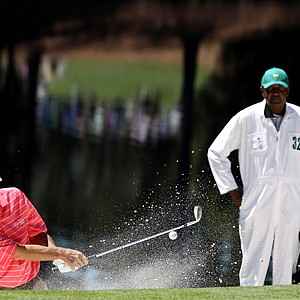 Ben Crenshaw hits from a bunker during the Par 3 Contest on the day before Round 1 of the Masters.