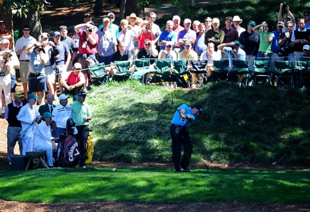 Phil Mickelson hits a shot before a gallery of fans during the Masters Par 3 Contest.