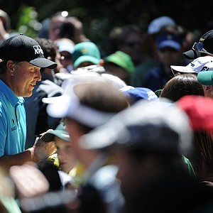 Phil Mickelson signs autographs for fans during the Masters Par 3 Contest.