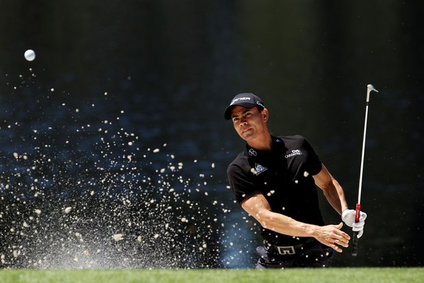 Camilo Villegas of Colombia plays a bunker shot during the Masters Par 3 Contest.