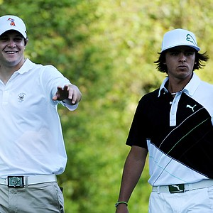 Amateur Peter Uihlein, left, and Rickie Fowler walk off a tee box during a practice round prior to the 2011 Masters.