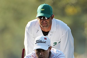 Nick Watney lines up a putt on the first hole with the help of caddie Chad Reynolds during the first round of the 2011 Masters Tournament at Augusta National Golf Club on April 7, 2011 in Augusta, Georgia.