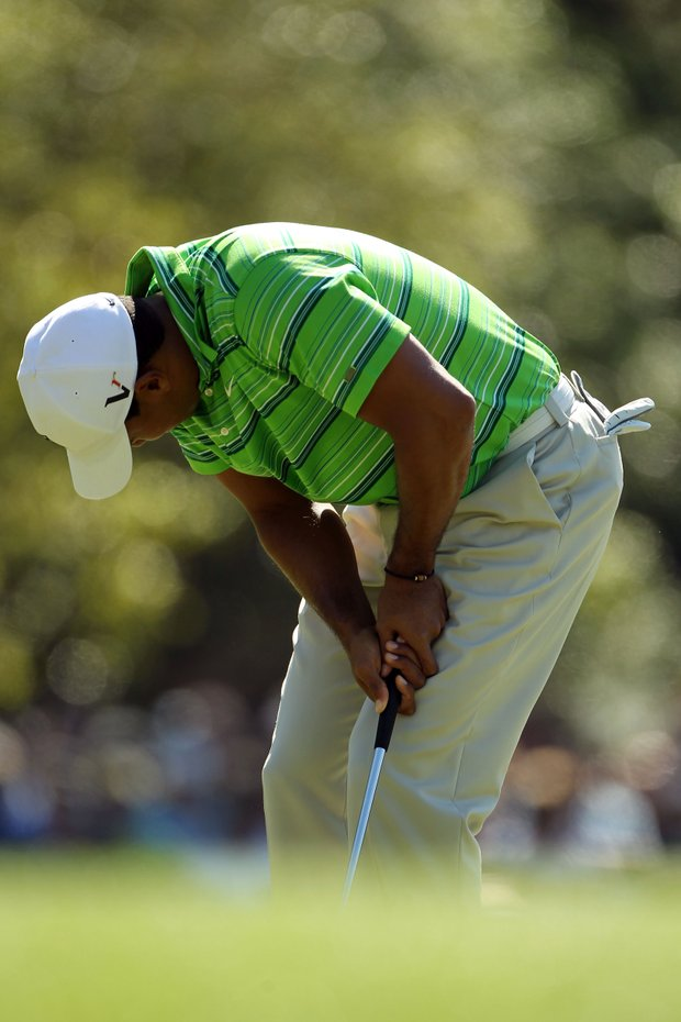 Tiger Woods reacts to a missed putt on the first green during the first round of the 2011 Masters Tournament at Augusta National Golf Club on April 7, 2011 in Augusta, Georgia.