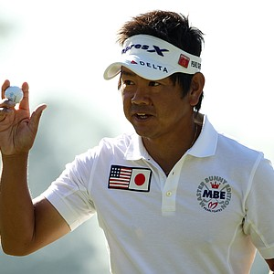 Hiroyuki Fujita of Japan waves to the gallery on the first green during the first round of the 2011 Masters Tournament at Augusta National Golf Club on April 7, 2011 in Augusta, Georgia.