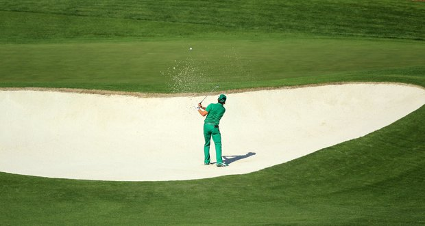Rickie Fowler hits from a bunker on the fourth hole during the first round of the 2011 Masters Tournament at Augusta National Golf Club on April 7, 2011 in Augusta, Georgia.