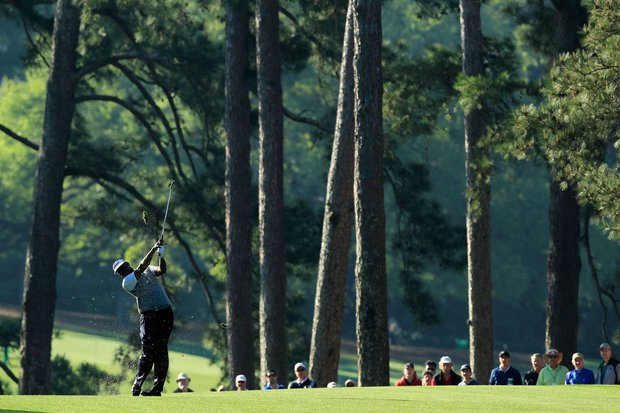 Vijay Singh of Fiji hits his approach shot on the first hole during the first round of the 2011 Masters Tournament at Augusta National Golf Club on April 7, 2011 in Augusta, Georgia.