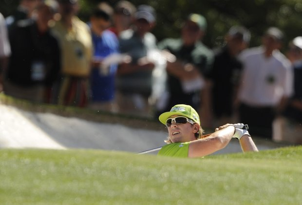 Hunter Mahan of the US hits out of a bunker on the first hole during the first round of the Masters golf tournament at Augusta National Golf Club on April 7, 2011 in Augusta, Georgia.
