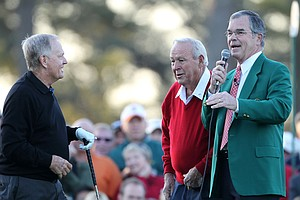 Jack Nicklaus, Arnold Palmer and William Porter Payne, the chairman of Augusta National Golf Club, wait on the first tee prior to starting the first round of the 2011 Masters Tournament at Augusta National Golf Club on April 7, 2011 in Augusta, Georgia.